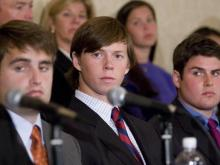 David Evans, Collin Finnerty and Reade Seligmann look on as Evans' attorney, Joseph Chesire, fields question from the media at a press conference held after North Carolina Attorney General Roy Cooper announced that remaining charges of first-degree kidnapping and sexual assault have been dismissed against Seligmann, Finnerty and Evans.