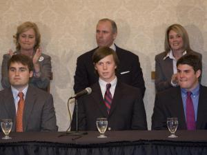 David Evans (left), Collin Finnerty and Reade Seligmann face the media as their families stand behind them in support.
