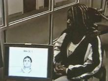 Durham police conduct a photo lineup with Duke lacrosse accuser Crystal Mangum on April 4, 2006.