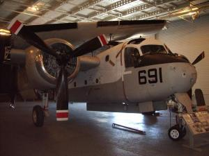 A Grumman Tracker aircraft on display at the U.S.S. Hornet Museum in California, its wings folded for below-deck storage on an aircraft carrier. (Museum photo)