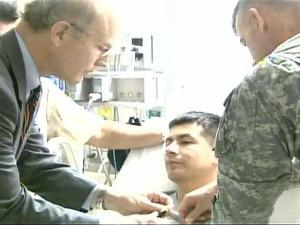 Pete Geren pinned the Purple Heart on one wounded soldier during his visit on Tuesday, May 22, 2007. Geren was named to the top Army job following a scandal over medical care at Walter Reed hospital.