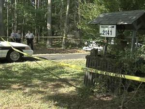 Crime-scene tape marks the edge of property at 2141 Marks Creek Road near Knightdale where Wake County sheriff's deputies were investigating a fatal shooting on Sunday, May 27, 2007.