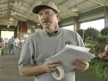 Kevin Blaine passes out fliers Saturday, June 30 at the State Farmer's Market across the street from where his daughter, Jenna Nielsen, was found dead behind a Raleigh convenience store. Blaine is offering a $10,000 reward for information leading to a conviction in the case.