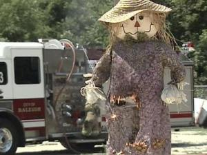 Firefighters used a scarecrow to demonstrate how easily fireworks can set clothing aflame.