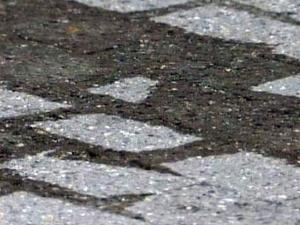 Numerous large stains mark the brick sidewalks along Fayetteville Street where food carts were located during the weekend festival.