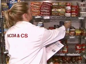 Janice Spruill of Raleigh is one of the state inspectors racing to cans of recalled food from store shelves. Castleberry's Food Co. recalled more than 25 brands after finding cans contaminated with the bacteria that causes botulism.