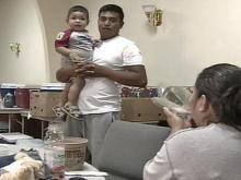 Pablo Romero brought his family to a Red Cross shelter at New Hope Baptist Church after a fire destroyed their apartment in north Raleigh early on Monday, August 21, 2007.