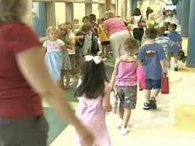 Schools Open to Late Buses, Crowded Classrooms