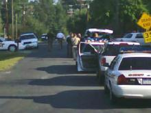 Police block off Constance Avenue in Durham after locating a car taken from the home of a homicide victim.