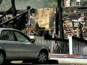 A woman was killed, and others jumped out of windows to escape a raging fire at the Highland Hills apartment complex in Carrboro on Sunday, Sept. 30, 2007.