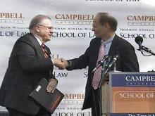 Raleigh Mayor Charles Meeker, right, congratulates Campbell University President Jerry Wallace on the school's decision to move its law school to Raleigh.