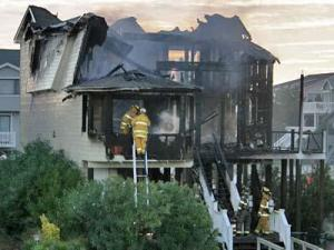 Firefighters continue to work at a house on Ocean Isle that burned earlier Sunday, Oct. 28. Seven college students were killed in the blaze. (Photo courtesy of Carmen Ledford)