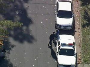 Sky 5 footage shows police cars near the scene of the shooting.
