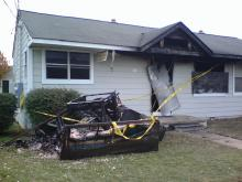 Burned furniture lies where firefighters piled it following a blaze at 1821 Bakers Grove Way in Raleigh on Thursday, Nov. 22, 2007.