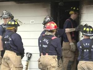 Firefighters investigate a fire that heavily damaged one side of a Raleigh duplex on Thursday, Nov. 22, 2007.