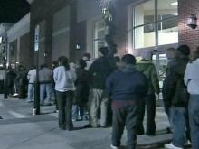 Lines outside stores waiting to open before dawn Friday, Nov. 23, 2007, were a good sign for retailers.