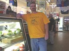 Scott Gandolph's stands inside his deli during the YouTube video shoot to promote downtown Smithfield.