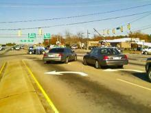 Police block the northbound lanes of Capital Boulevard after a wreck knock a power pole down into the roadway.