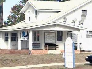 The owner is also accused of not paying rent on the Express Satellite Service building.