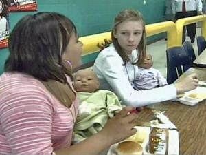 Seventh-graders in Elizabeth D'Herde's life-skills class learn about the responsibilities of parenthood by caring for electronic dolls.