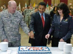 Maj. Gen. William E. Ingram, Jr., adjutant general of the North Carolina National Guard; Bryan E. Beatty, secretary of the state  Department of Crime Control and Public Safety; and Shawne M. Johnson, president of the North Carolina National Guard Association cut a National Guard birthday cake at the Military Center in Raleigh on Thursday, Dec. 13, 2007. (NGNC PAO Photo by Spec. Desmond Marks)