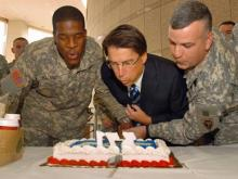 Charlotte Mayor Patrick McCrory (center),  Pfc. Dejon L. Holland (left) and 1st Sgt. Mo Fregia cut a National Guard birthday cake and blow out candles at the Charlotte Municipal Building on Thursday, Dec. 13, 2007. (NCNG PAO Photo by Tech. Sgt. Brian Christiansen)