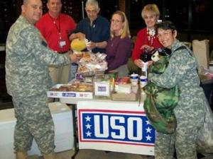 """Southwest Airlines and the USO made """"Operation Christmas Miracle"""" possible and flew 180 Texas soldiers, temporarily stationed at Fort Bragg, home for Christmas, free of charge. (Photo by John Lucy)"""