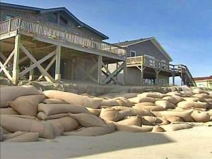 The sandbags protecting these beach houses along the North Carolina coast from the Atlantic Ocean will have to be removed by spring 2008, according to a state regulation.