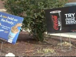 Wilson wants restaurants to follow a two-sign limit. Businesses say extra signage is necessary.
