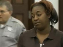 Mom Charged in Fire That Killed Daughters