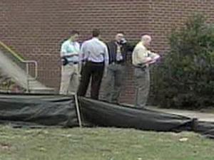 Police at N.C. State University search for masked men wanted in connection with an armed robbery on campus Tuesday, March 11, 2008.