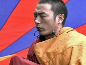 A Buddhist monk leads prayers during a pro-Tibet demonstration outside the State Capitol Building in Raleigh on Saturday, March 29, 2008.
