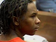 "Laurence Alvin Lovette, during an April 10, 2008, court appearance, looks on as prosecutor Tracey Cline tells the court he had told people that someone ""had to be killed"" during the robbery of Abhijit Mahato."