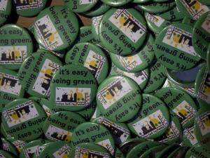 Volunteers at the Earth Day celebration in Durham Central Park gave away buttons promoting the event.