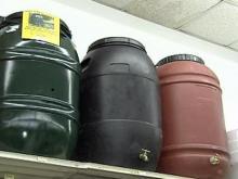 Rain barrels collect dust