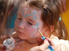 Adults and youth stuffed their faces in a sweet-potato pie eating contest, and children got their faces painted, while strains of banjos, rock and Gospel music filled the air at the Smithfield Ham & Yam Festival on Saturday.