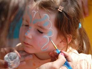 Three-year-old Candice, of Grantham, holds perfectly still while getting her face painted.