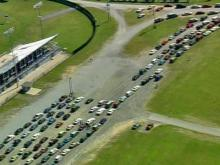 Hundreds camped out overnight to get ahead in line for $40 pre-paid gas card on Thursday, May 22, 2008. The lines backed up traffic all the way to Interstate 85.