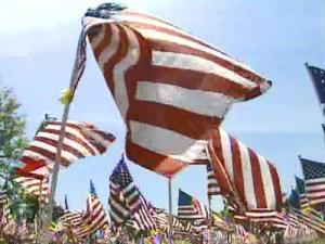Full-sized American flags – 1,500 of them – covered a field at Festival Park on Monday, May 26, 2008. Each billowing banner had a yellow ribbon attached with the name of a soldier written on it.