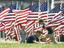 Festival-goers relax and play in a field of 1,500 American flags during Fayetteville's Festival Park on Monday, May 26, 2008.