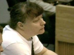 Lynn Paddock listens to one of her adopted children testify at her murder trial on May 30, 2008.