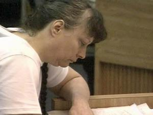 Lynn Paddock listens to testimony in her murder trial on June 4,2008.