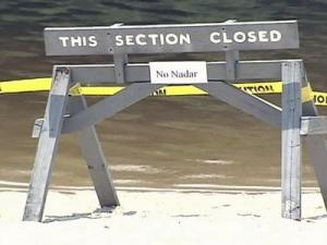 Tests detected a bacteria normally found in feces in two Falls Lake swimming areas.