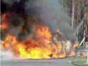 This picture from YouTube shows a Youngsville police car engulfed in flames.