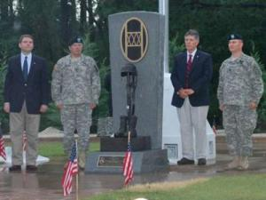 Jon Williams, state deputy secretary of Crime Control and Public Safety; Maj. Gen. William E. Ingram Jr., adjutant general of the NC National Guard; Tom Russell, head the Step up for Soldiers charity; and Lt. Col. Jack Mellot, Commander 120th Combined Arms Battalion, (left to right) stand next to the Fallen Soldier Memorial in Wilmington after its dedication on Saturday, June 21, 2008. (NCNG PAO photo by MSgt. Dwight Green)
