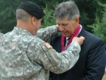 Maj. Gen. William E. Ingram Jr., the Adjutant General, presents the NC Civilian Meritorious Service medal to Tom Russell, of Step up for Soldiers, at the unveiling of the Fallen Soldier Memorial dedication in Wilmington on Saturday, June 21, 2008. The award was presented to Russell for his dedication to the men and women of the NC National Guard. Step up for Soldiers assists in building projects and other events in support of military men and women around the state. (NCNG PAO photo by MSgt. Dwight Green)