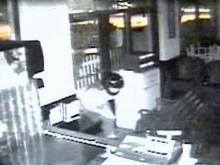 Surveillance video shows a man throwing a rock through the front door and entering the Hot Point Deli, 1284 Buck Jones Road in Cary, on Saturday, June 21.