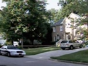 A Cary police car sits outside the home of Nancy and Brad Cooper at 104 Wallsburg Court on the afternoon of July 15, 2008, hours after police ruled Nancy Cooper's death a homicide.