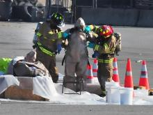 Emergency HAZMAT teams assemble at a staging area near the TA Truck Stop to clean and decontaminate after their inspection of a hazardous chemical leak from a tanker truck. The emergency occurred Wednesday morning near exit 106 off of I-95. (Photo courtesy of Gray Whitley   Wilson Daily Times)