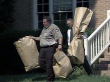 Investigators return to slain woman's home